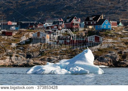 An Iceberg Floating In The Coastline Of Ilulissat, Greenland.
