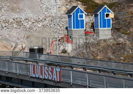 The Ilulissat Signboard On The Bridge Of Mittarfimmut Aqq At The Harbour Of Ilulissat In Greenland.