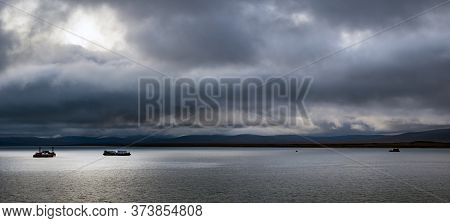 Panoramic Scenery Of A Three Ships On The Bering Sea And The St Lawrence Island In The Background At