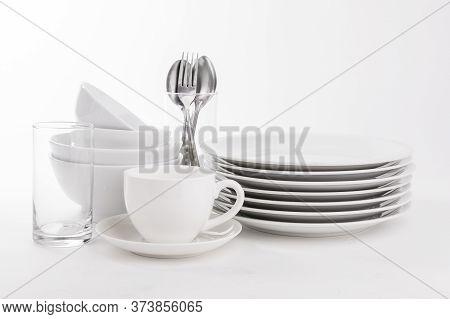 Set Of White Dishes On White Background