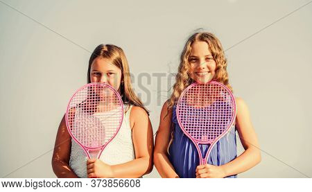 Relaxing After Training. Summer Outdoor Games. Play Tennis. Childhood Happiness. Small Girls With Te