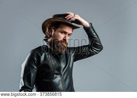 Cowboy Style. Fashionable Man Dressed In Leather Jacket. West Fashion Model. Handsome Man In Cowboy