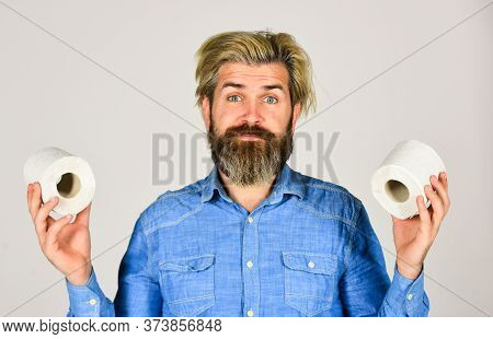 Hygiene And Sanitary. Man In Public Toilet. Diarrhea Concept. Man Holding Toilet Paper Roll In Super