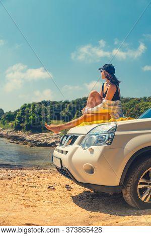 Happy Woman At Sea Summer Beach Sitting At Car Hood