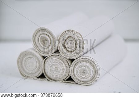 Towels Rolled Clean White Bathroom Accessories. Stack Of Folded Fabric Material Hygiene Napkin For S