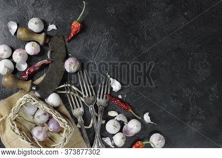 Dried Chili Peppers And Garlic On Dark Background