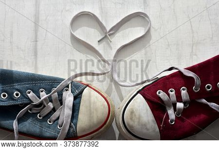 Drawing Love With Laces On Red/blue  Shoes. Original Valentine's Day Love Concept