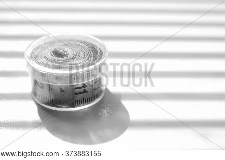 Measuring Tape On The Shiny Table. Bw Photo.