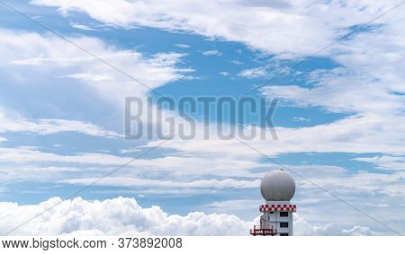 Weather Observations Radar Dome Station Against Blue Sky And White Fluffy Clouds. Aeronautical Meteo