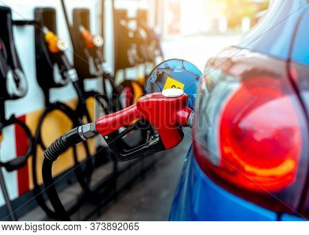 Car Fueling At Gas Station. Refuel Fill Up With Petrol Gasoline. Petrol Pump Filling Fuel Nozzle In