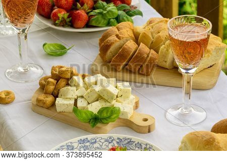 Summer Picnic Table With Rose Wine, Cheese And Strawberry