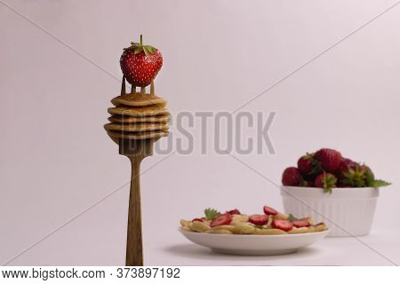 Small Pancakes. Wooden Fork With Mini Pancakes And Strawberries. Selective Focus, Pancake Porridge