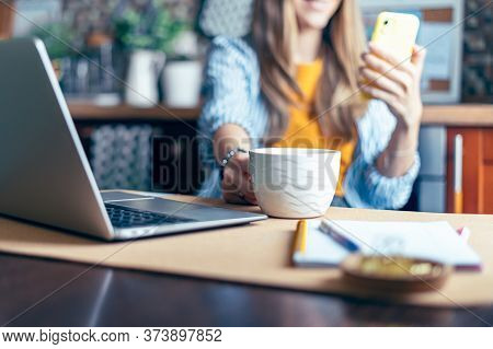 Business Woman Having A Facetime Video Call. Happy And Smiling Girl Working From Home Office Kithcen