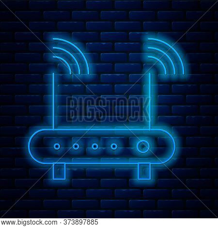 Glowing Neon Line Router And Wi-fi Signal Symbol Icon Isolated On Brick Wall Background. Wireless Et