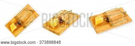 Conceptual Picture Of A Mousetrap With A Piece Of Cheese On A White Background In Several Different