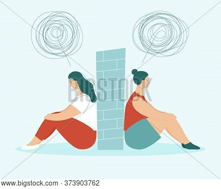 Two Sad Women In Quarrel Sitting Back To Back. Between Them Wall. Concept Of Problems In Partnership