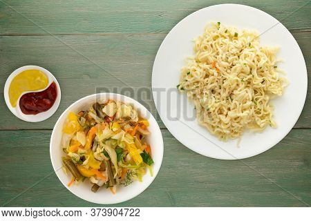Vermicelli On A White Plate On Green Wooden Background. Vermicelli On A Plate With Vegetarion Salad