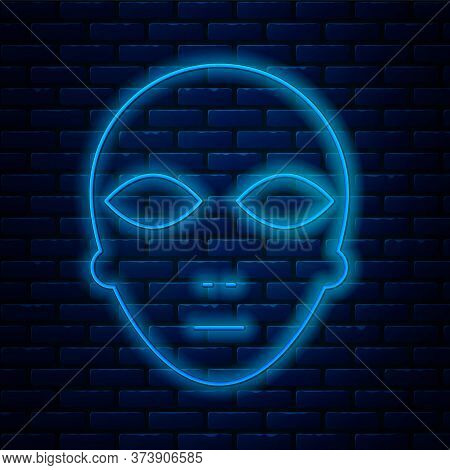 Glowing Neon Line Alien Icon Isolated On Brick Wall Background. Extraterrestrial Alien Face Or Head