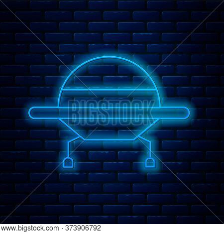 Glowing Neon Line Ufo Flying Spaceship Icon Isolated On Brick Wall Background. Flying Saucer. Alien