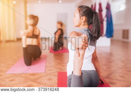 Beautiful Young Girls Doing Hatha Yoga On Rugs, Relax, Health Care.