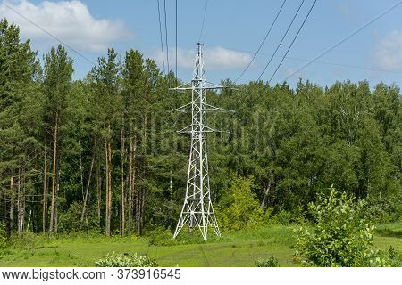 High-voltage Support In The Forest On A Clearing For Transmitting High Voltage. High Voltage Power L