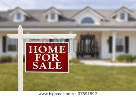 Home For Sale Real Estate Sign in Front of Beautiful New House.