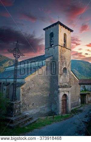 Typical Church In A Small Village In The Ardeche District, Southern France, Under A Dramatic Sunset