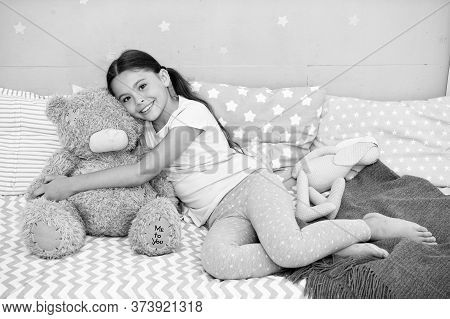 Ideal For Cuddling. Happy Child Hold Teddy Bear Toy In Bed. Little Girl Play With Soft Toy. Toy Shop