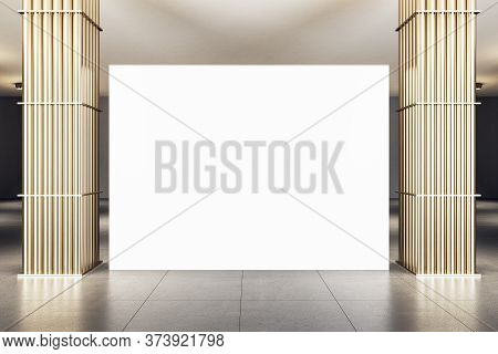 Modern Exhibition Interior With Golden Pipe Columns And Blank Banner. Gallery And Presentation Conce
