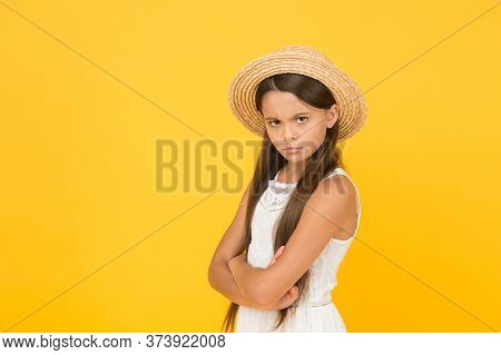 Dissatisfaction. Moody Little Girl Wearing Elegant Hat. Summer Holiday. Summer Tour. Leisure And Ent
