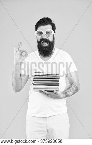 Top Literature Books, Recommended. Bearded Man Show Ok Sign. Student Hold Books For Literature Readi