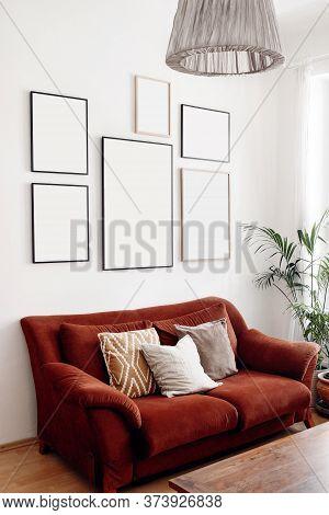 Blank Picture Frames Mockups On White Wall. White Living Room Design. View Of Modern Boho, Scandi St