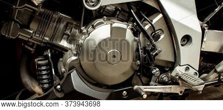 Silver Engine Of Sports Motorcycle Closeup. Gearbox, Front Wheel Motorbike.  Chrome Engine Parts, Pi