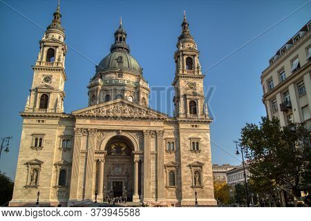 Wonderful facade of St. Stephen's Basilica is a Roman Catholic Cathedral in Budapest, Hungary on a background of clear blue sky.
