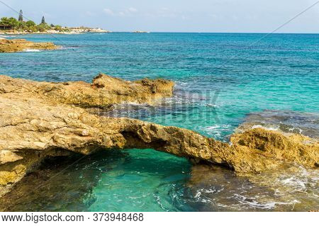 Crete Island Seascape Background. Greece Travel Background with Turquoise Sea and Coast Cliffs.