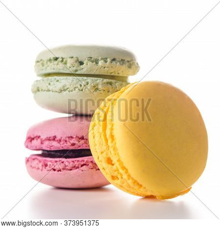 Three Delicious Multi Flavored Macaroons On White Background.