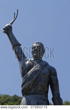 Ste-marie De Campan, France, June 24, 2020 : A Bronze Statue Depicting A Cyclist Holding His Fork On