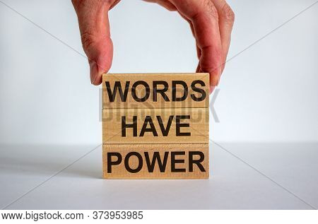 Male Hand Placing A Block With Word 'words' On Top Of A Blocks Tower With Words 'have Power'. White