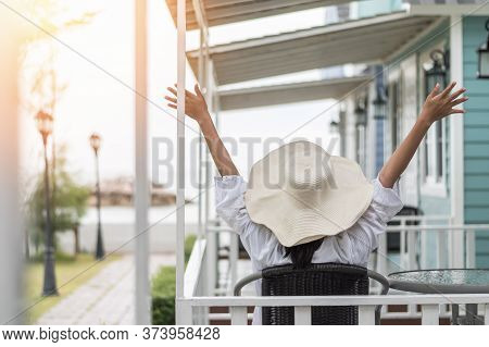 Summer Vacation Lifestyle With Young Girl Wearing Sunscreen Hat On Sunny Day Relaxing Taking It Easy
