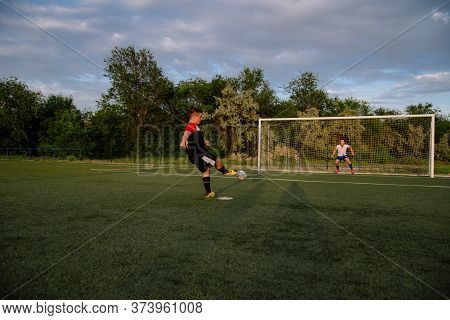 Soccer Player Hits The Ball. Football Player Kicking Penalty