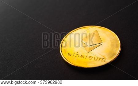 Golden Ether Coins Or Ethereum Network Exchange On Black Background, Blockchain And Money Cryptocurr