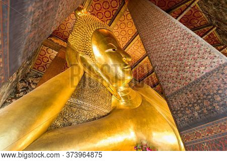 BANGKOK, THAILAND - SEPTEMBER 23, 2015: The Reclining Buddha of Wat Pho Temple in Bangkok. The temple was founded in the 16th century and is considered one of Bangkok's oldest temples.