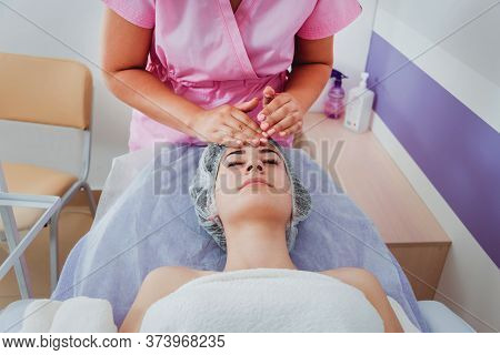 Facial Cosmetic Procedure In Spa Salon. The Procedure For Applying A Mask