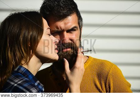 Man And Woman With Serious Faces On White Stripy Background