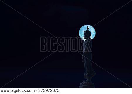 Sunday Buddha And Blue Moon On Night Sky In The Asanha Bucha Day