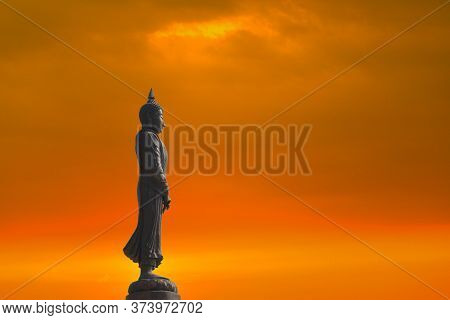 Sunday Buddha And Sunset Cloud On Sky On The Asanha Bucha Day