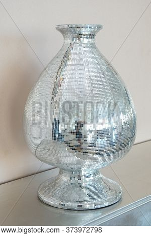 Vase Decorated With Mosaic Of Mirror Glasses On The Table. The Glued The Mirror Vase With Some Refle