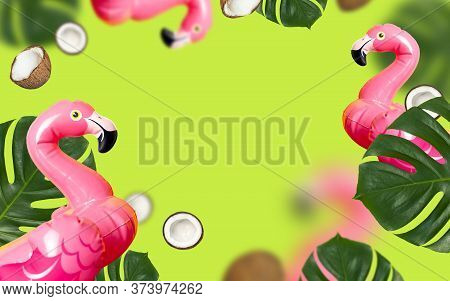 Creative Summer Background. Flying Inflatable Pink Mini Flamingo Tropical Leaf Monstera Coconut On G