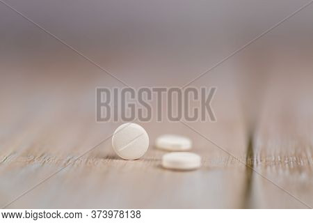 Home Therapy. Close-up Round White Pills. Macro