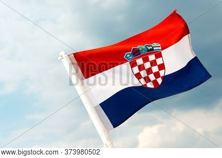 Croatian National Flag Flying From The Yacht Flagstaff On Windy Day, Adriatic Sea